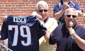 Carl Kusch gets his own New England Patriots jersey from team owner Robert Kraft at Founders day in 2004. (File photo)